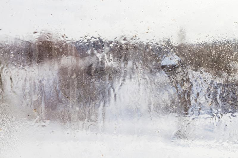 blurry view of village through frozen window royalty free stock photo