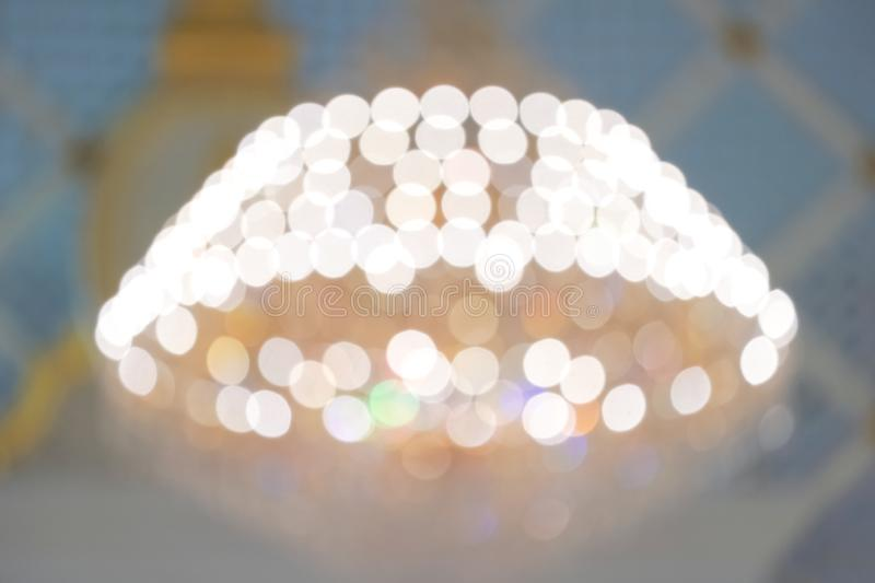 Blurry yellow rainbow chandelier and bokeh for luxury or happy holiday background. christmas, new year, birthday, anniversary stock images