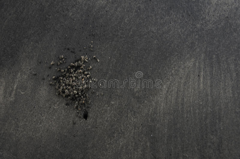 Blury, Movement, Ripples in shallow water over a Black sand Beach royalty free stock photo