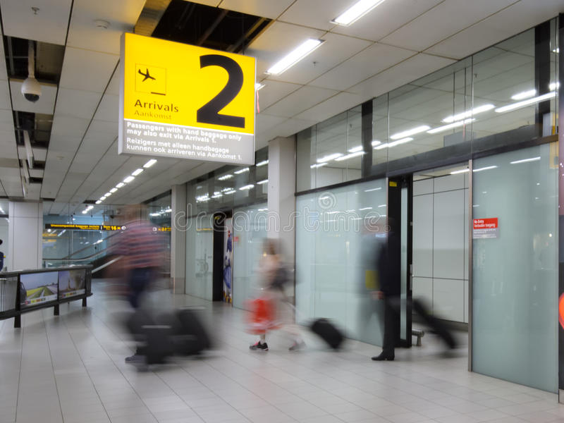 Blury passenger or tourist at the arrival terminal 2 of Amsterdam Airport royalty free stock images