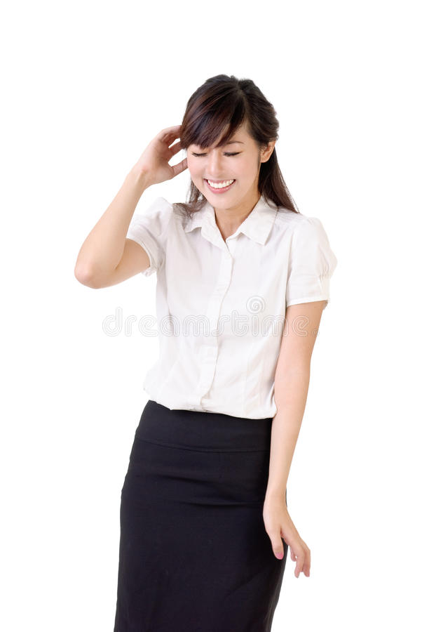 Blush. Smiling business woman with blush expression over white background royalty free stock photos