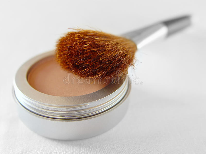 Blush. A facial blush with a brush over white stock photos