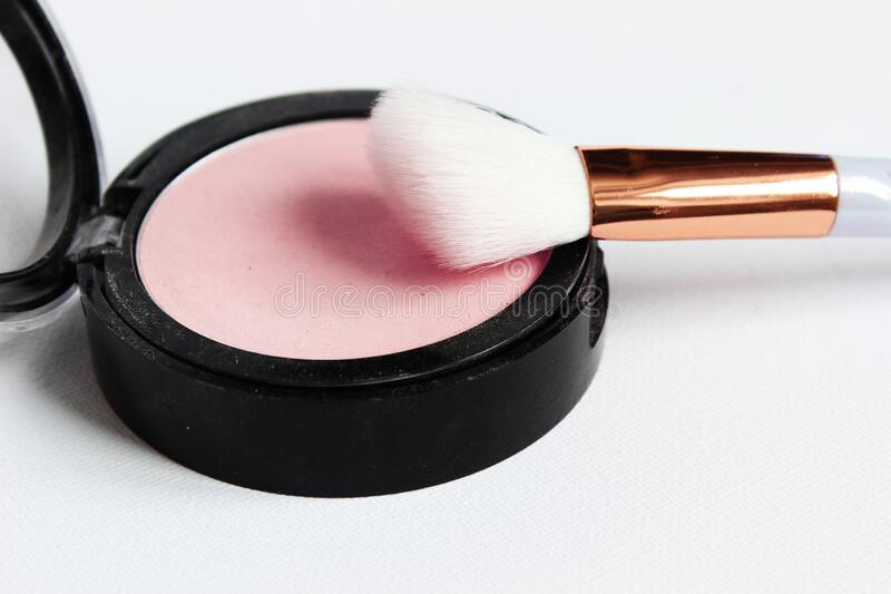 Blush pink with white brush. Application of cosmetics. Naturalness stock photography