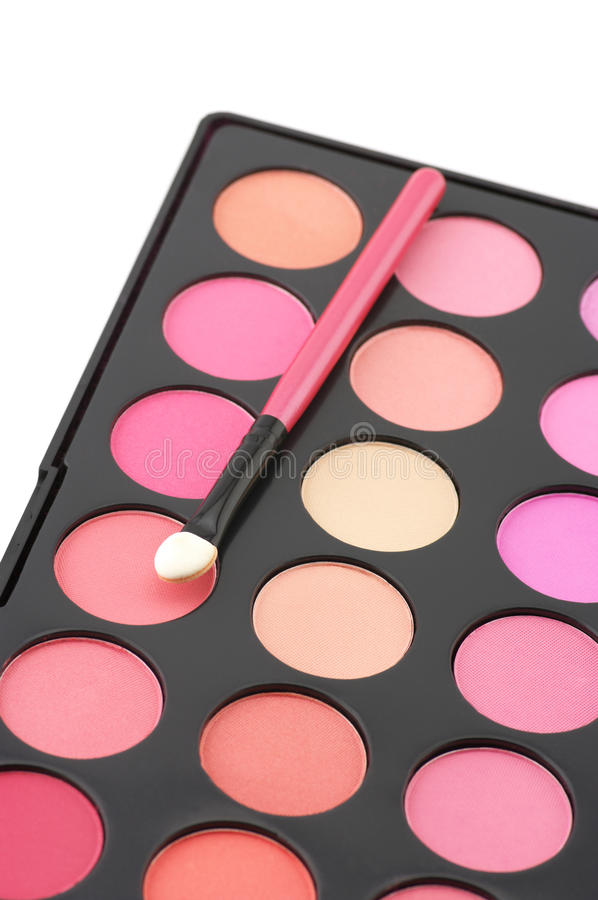 Blushes palette and applicator. Palette of colorful blushes and applicator on white background stock photo