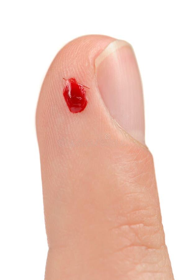 Blut auf geschnittenem Finger stockfoto