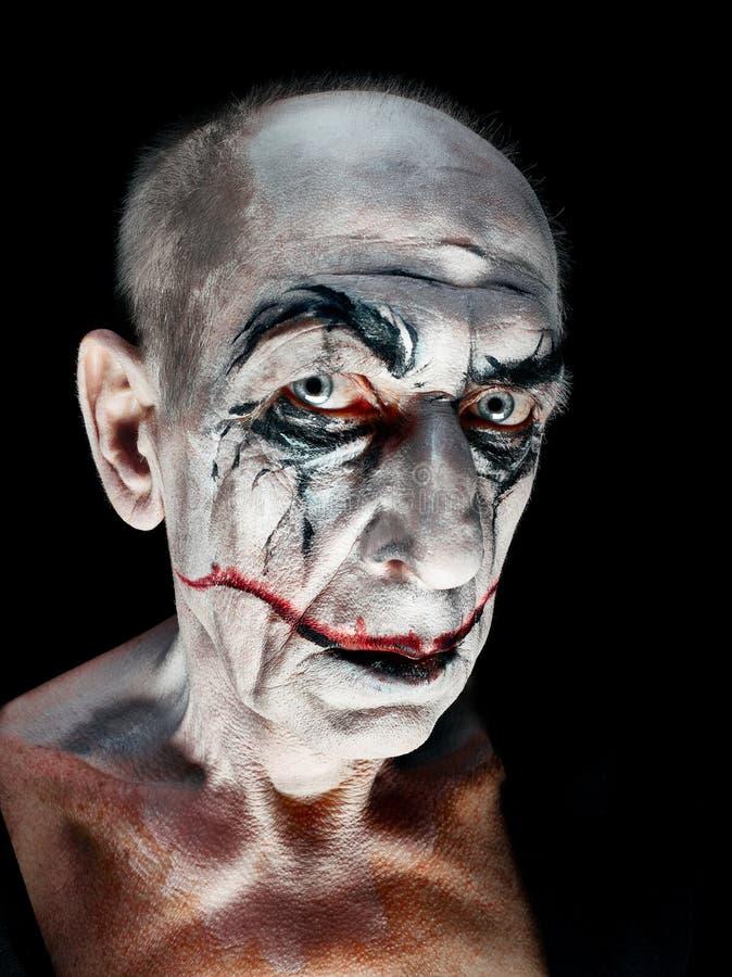 Blutiges Halloween-Thema: verrücktes maniak Gesicht stockbilder