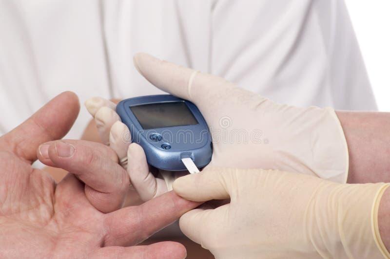 Blutzuckerprüfung. lizenzfreie stockbilder