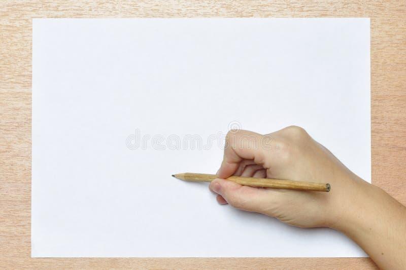 Download Blyertspenna i hand. fotografering för bildbyråer. Bild av ställe - 37344987
