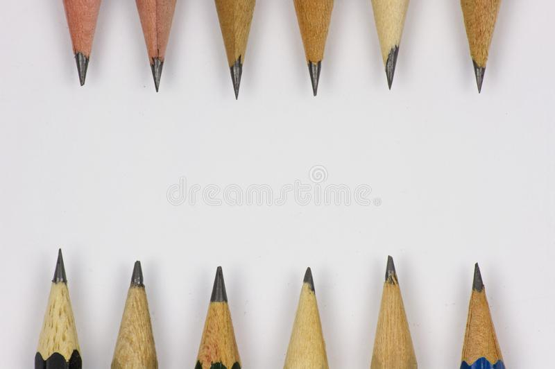 Blyertspenna med att v?ssa p? vitbokbakgrund arkivfoto