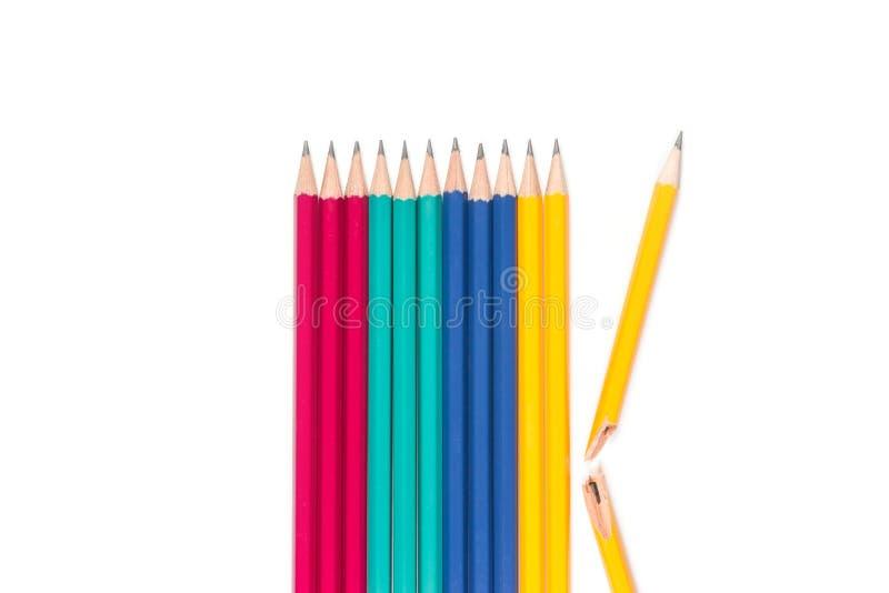 Blyertspennor och bruten blyertspenna på vit bakgrund royaltyfria foton