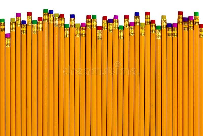 Blyertspennor på olika höjder för olika fel royaltyfri foto