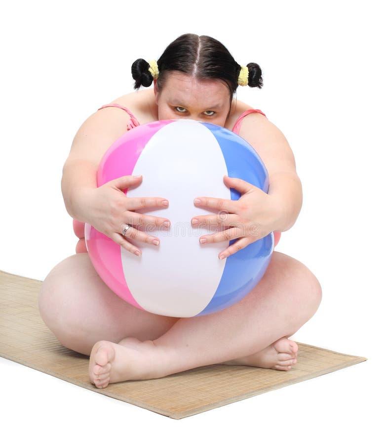 Blyg överviktig kvinna. arkivfoton