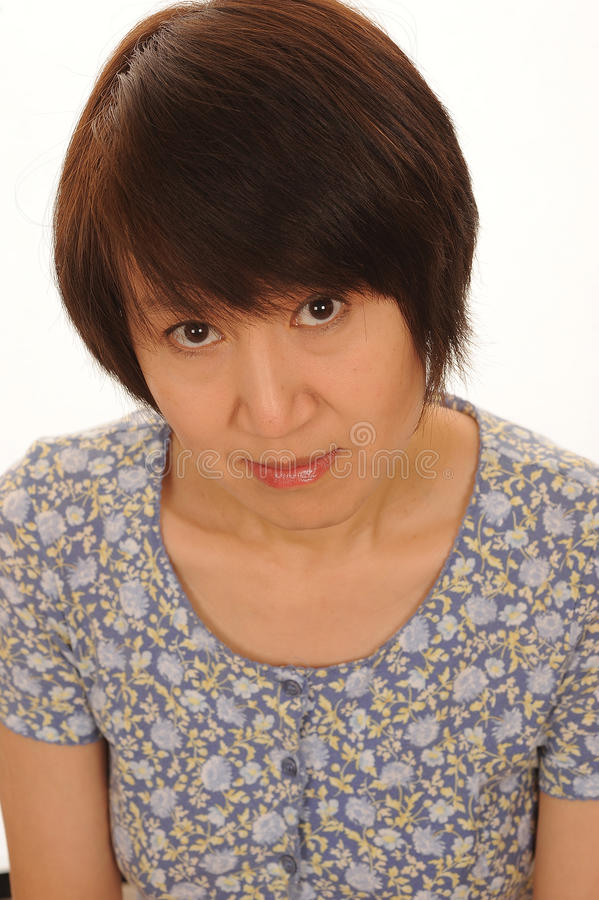 Blyg asiatisk kvinna fotografering för bildbyråer