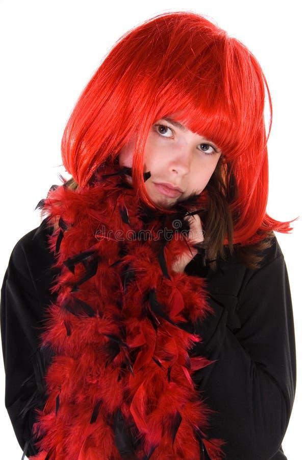 blyg wig för flickared arkivbild
