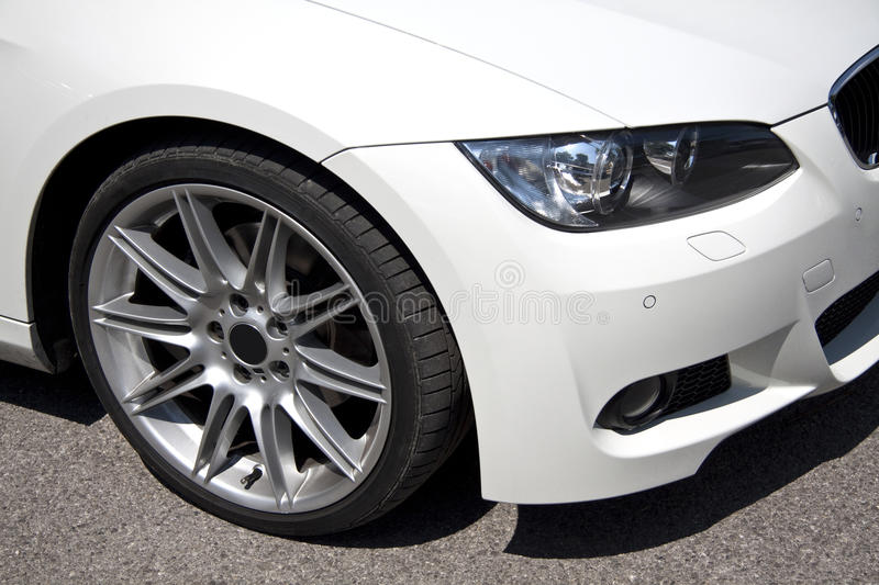 BMW. Front detail view of a Bmw 3 Series in white color royalty free stock photography