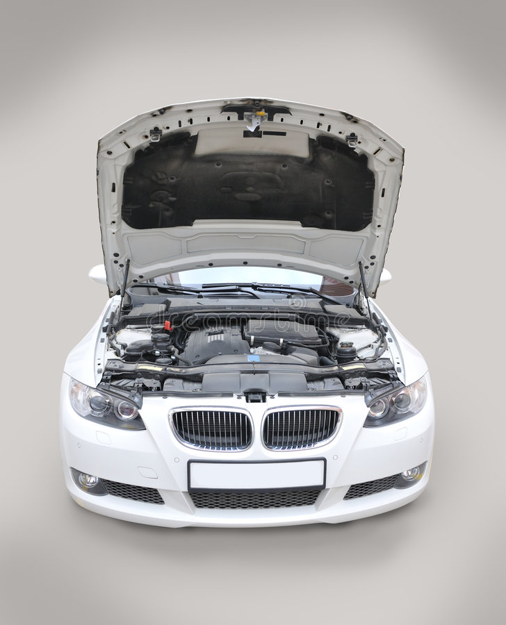 BMW 335i Bonnet open. A white BMW 335i convertible sports car's front open royalty free stock image