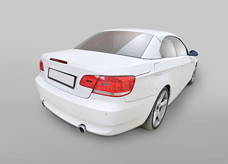 BMW 335i convertible car back corner view. A white BMW 335i convertible sports car's back-corner view isolated stock photography