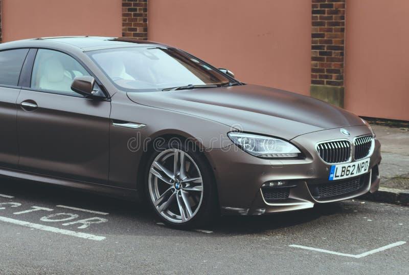 在停车位的BMW 免版税库存照片