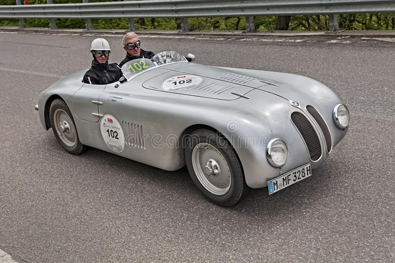 BMW 328 Berlin-Rom Touring Roadster 1937-1941 in Mille Miglian. Classic racing car BMW 328 Berlin-Rom Touring Roadster 1937-1941 runs in Mille Miglia 2013, the royalty free stock image