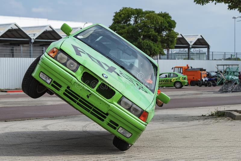 BMW car rides sideways on two wheels, at an auto show in the city of Halle Saale, Germany, 04.082019 stock image