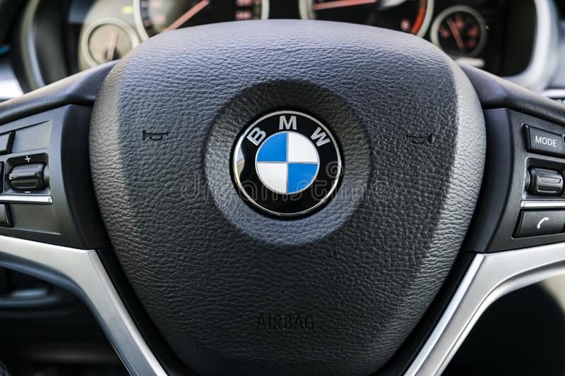 BMW X5 2018 close up of steering wheel and dashboard. Modern car interior details. Car detailing. Media control buttons stock photos