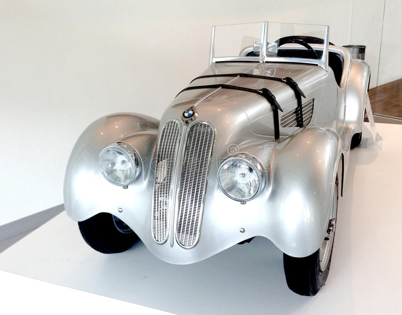 BMW 328 collector. Mini car for child exposed in the big BMW store in Paris in France royalty free stock photos