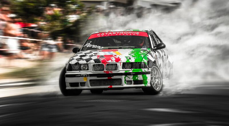 BMW E36 in action during a drift race. Guimar, Spain, July 15, 2017: BMW E36 in action during the 5th Drift Race De Guimar royalty free stock images