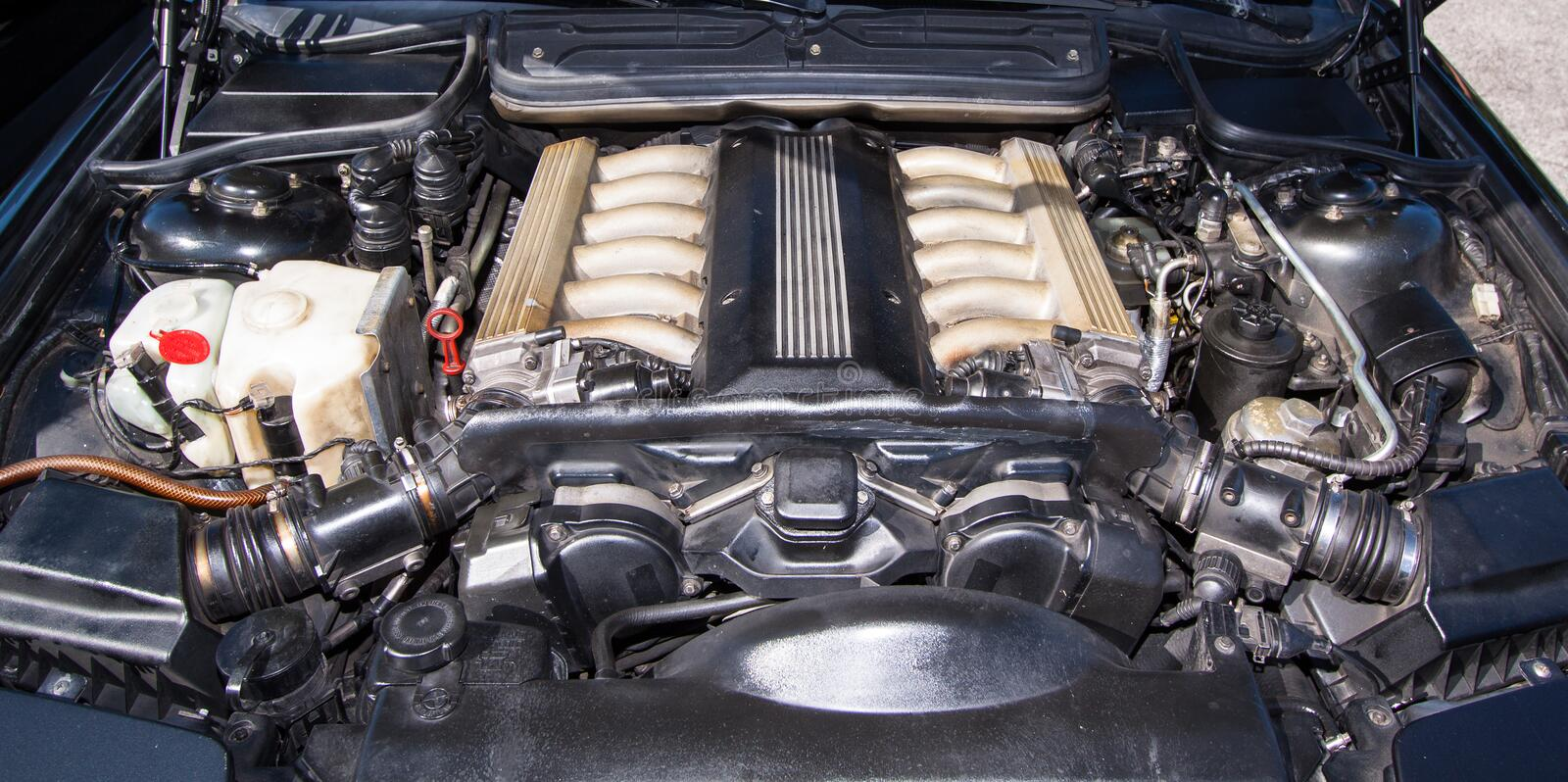 Bmw 850 engine. Engine of BMW 850 csi - into open bonnet you can see details of big V12 engine stock photo