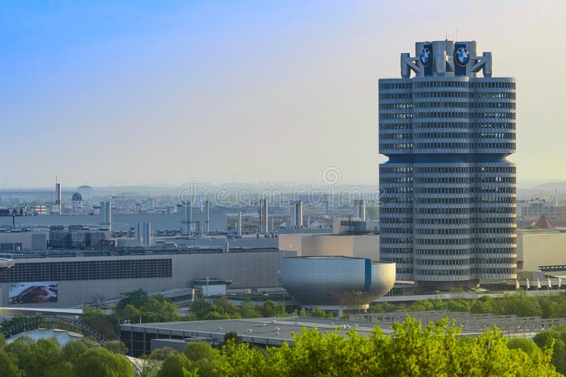 BMW Headquarters office tower and manufacturing plants. Munich, Germany - April 22, 2018: BMW Headquarters office tower, manufacturing plants and industrial stock photos