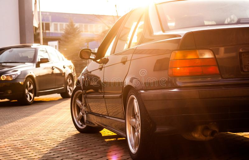 BMW LOVE. Beautiful sunset shot of BMW E36 and E60 in background stock image