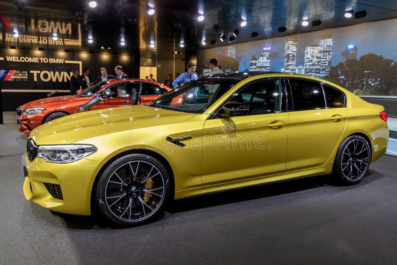 BMW M5 Competition car. GENEVA, SWITZERLAND - MARCH 5, 2019: BMW M5 Competition car showcased at the 89th Geneva International Motor Show yellow auto automobile stock photos