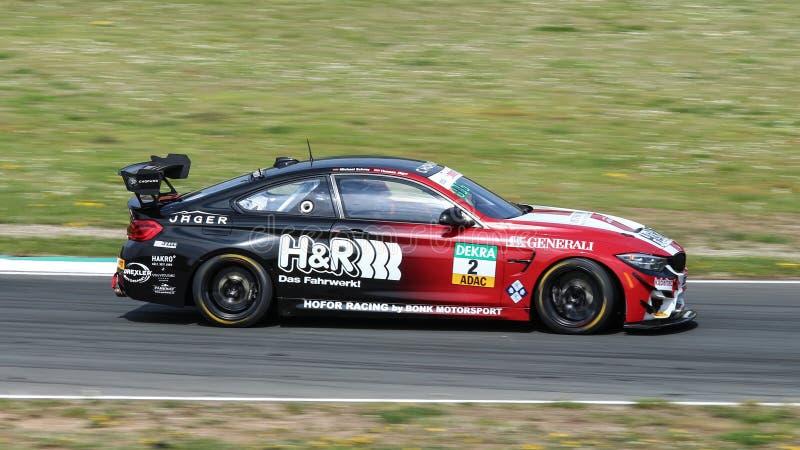 BMW M4 door Hofor Racing tijdens ADAC GT stock afbeelding