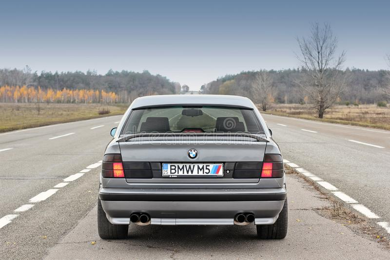 Chernigov, Ukraine - November 8, 2017. BMW M5 E34. Gray BMW stands on the road. BMW M5 E34. Gray BMW stands on the road royalty free stock photos