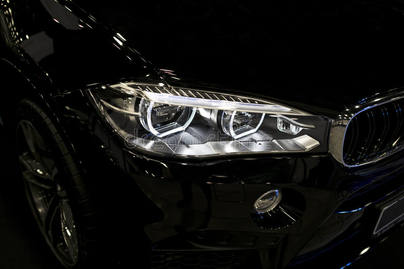 BMW X6M 2017. Headlight of a modern sport car. Front view of luxury sport car. Car exterior details. stock photos