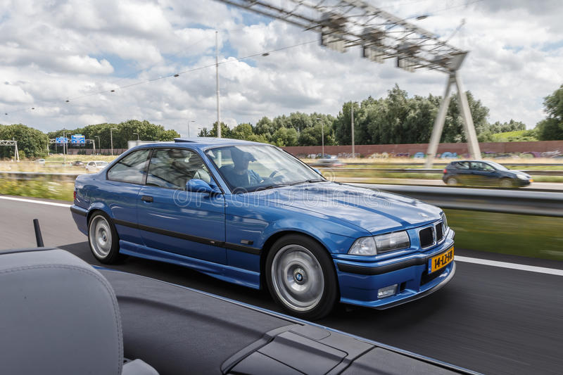 BMW M3. Netherlands June 17, 2016 BMW e36 M3 and e46 M3 driving on the highway at Holland royalty free stock photo