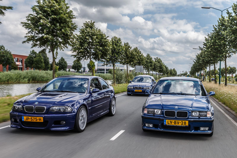 BMW M3. Netherlands June 17, 2016 BMW e36 M3 and e46 M3 driving on the highway at Holland stock photography