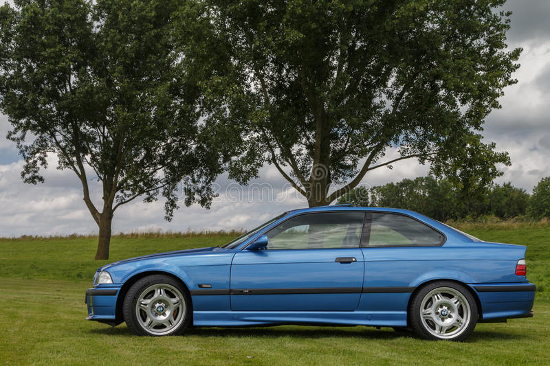 BMW M3. Netherlands June 17, 2016 BMW e36 M3 and e46 M3 on a field stock photos