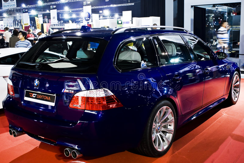 BMW M5 Touring Station Wagon - MPH. BMW M5 Touring Station Wagon, a family sized, ultra fast, and sporty vehicle. Without the 155mph electronic limiter the new stock image