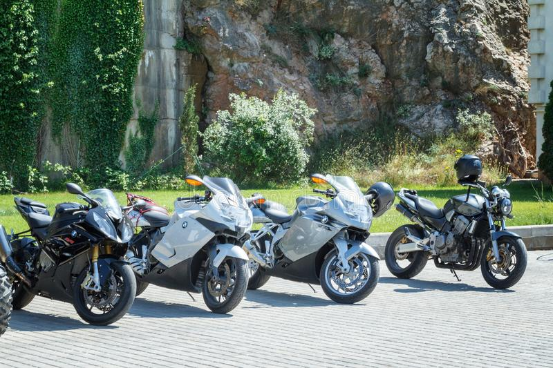 BMW motorcycles are on the waterfront against the rock, July 9, 2018 embankment in Balaklava royalty free stock photos