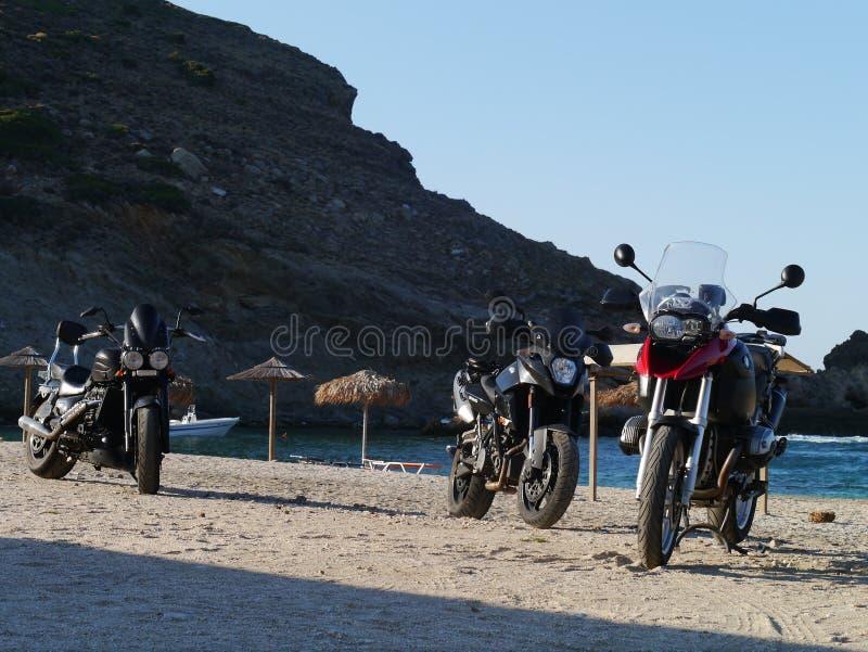 BMW R1200GS, KTM 990 SMT and Triumph Rocket 3 on Zarko beach Evia. Greece royalty free stock images