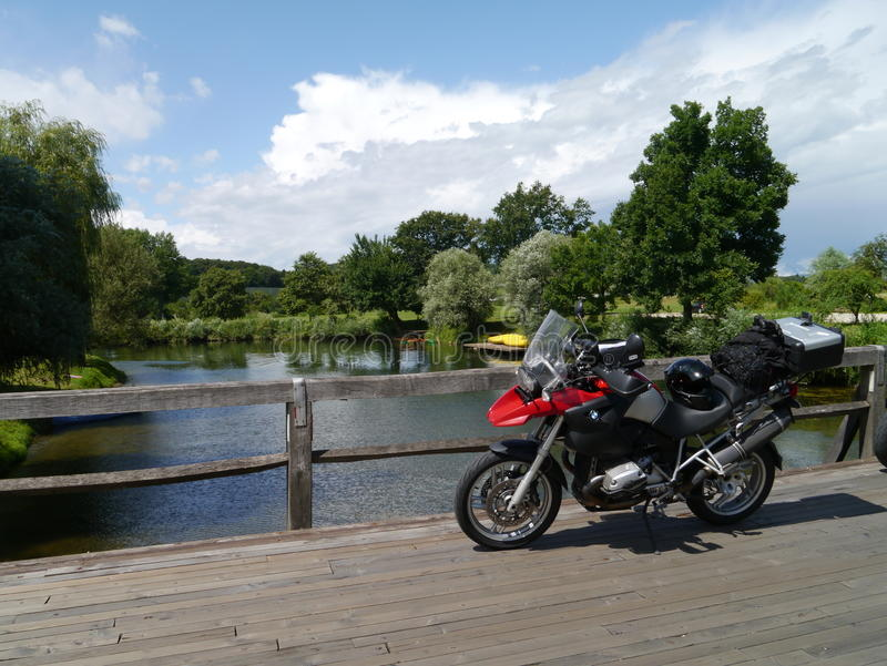 BMW R1200GS motorcycle on a wooden bridge over a river in Slovenia. royalty free stock photo