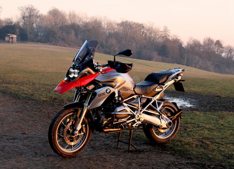 BMW R1200GS TE motorcycle on Reigate hill on the North Downs Way. Red and silver BMW R1200GS TE motorcycle on Reigate hill on the North Downs Way at a winter royalty free stock image