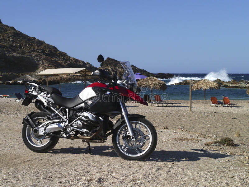 BMW R1200GS Zarkos beach , Evia in Greece. Red and silver BMW R1200GS at Zarkos beach, Evia in Greece stock photos