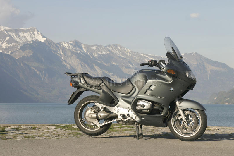 BMW R1150RT motorcycle at Boningen, Interlaken, Switzerland. Lake Brienzsee and mountains in the background stock photo