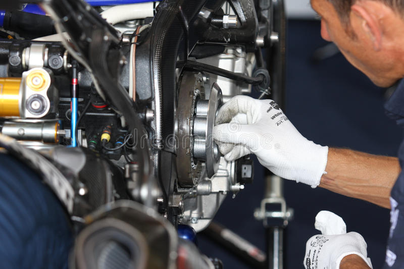 BMW S1000 RR SBK Clutch Maintenance. BMW S1000 RR - BMW Motorrad Italia SBK Team in the world Superbike Championship SBK Clutch Maintenance stock photography