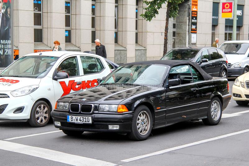 BMW 3-series. Berlin, Germany - September 10, 2013: Black convertible car BMW 3-series E36 in the city street stock photography