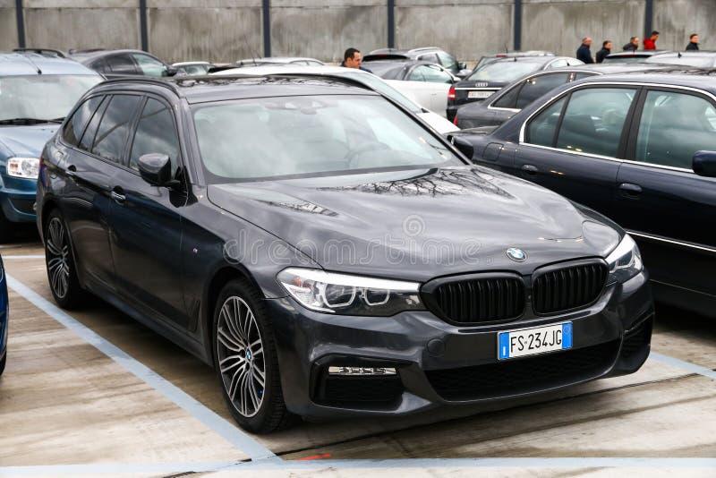 BMW 5-series. Geneva, Switzerland - March 10, 2019: Estate motor car BMW 5-series G31 in the city street royalty free stock photos