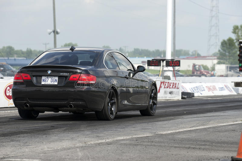 Drag racing. Napierville dragway, July 25, 2015, rear side view of black BMW 335 car ready to go at the starting line on the track royalty free stock images