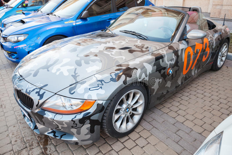 BMW z4 roadster car with camouflage color scheme. Saint-Petersburg, Russia - April 11, 2015: BMW z4 roadster car with camouflage color scheme stands parket on royalty free stock photography