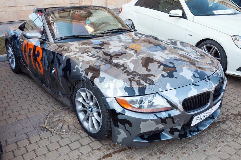 BMW z4 roadster car with camouflage colors. Saint-Petersburg, Russia - April 11, 2015: BMW z4 roadster car with camouflage color scheme stands parket on the stock photography